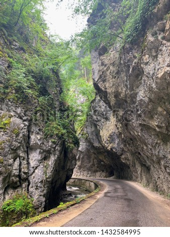 The dangerous road in Trigrad's gorge Bulgaria between the enormous rocks #1432584995