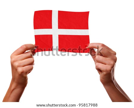 The Danish flag in the woman hands. closeup