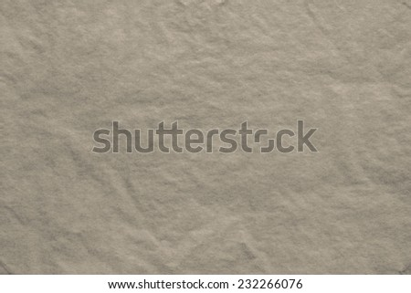 the dark-beige textured background from a thin tissue paper or a tracing-paper