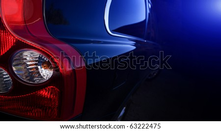 The dark blue car on a black background