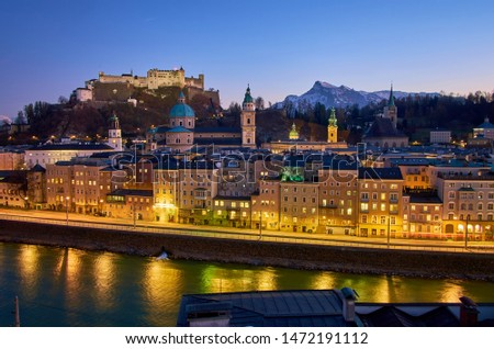 The dark evening sky over old Salzburg gives the illuminated streets even more magical charm, Austria #1472191112