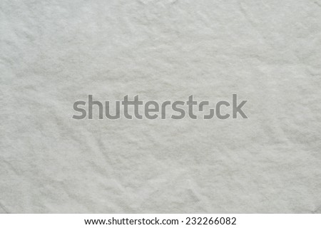the dark white textured background from a thin tissue paper or a tracing-paper