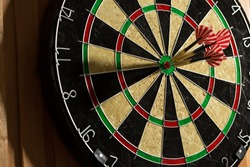 The darts isolated on wooden background
