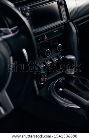 the dashboard and the gear lever of a sports car #1541336888