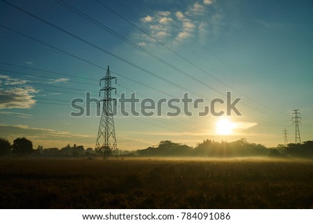 The Dawning View of High-voltage Electricity Pylons in Vientiane Capital, Laos #784091086