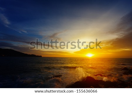 The dazzling bright sunset over a tropical ocean. Thailand
