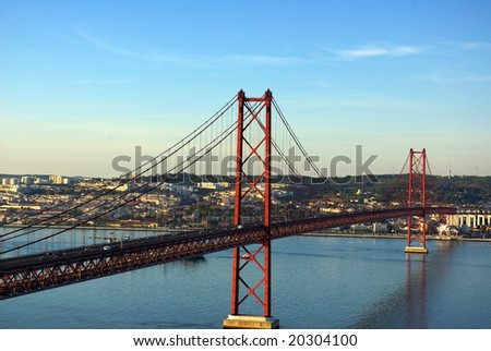 The 25 de Abril Bridge is a suspension bridge on river Tejo, Lisboa.