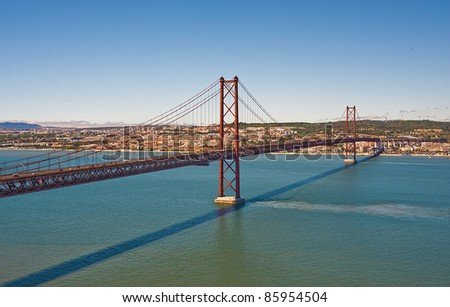 The 25 de Abril Bridge (25th of April) over river Tejo