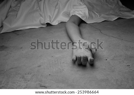 The dead woman\'s body. Focus on hand
