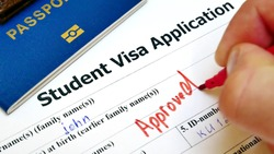 The decision to grant a visa. Pen voting approved in checkbox in blank Student Visa application form with passport and pen. Document with passport, apply and permission for foreigner country