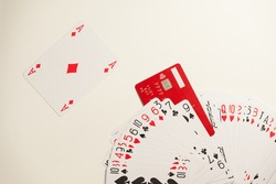 The deck of playing cards and a red credit card imitating a joker