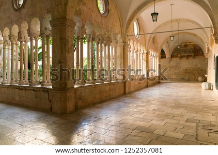 The decorative columns and arches of the corridors of the 13th Century Franciscan Monastery in Dubrovnik, Croatia. #1252357081
