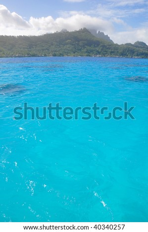 The deep blue waters of the lagoon in Tahiti.