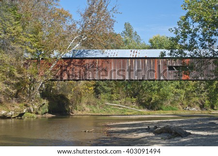 The Deers Mill Covered Bridge crosses the Sugar River in west central Indiana in Shades State Park, Montgomery County, Indiana