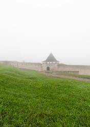 The defensive fortress of the Khotyn ancient castle in the morning fog.