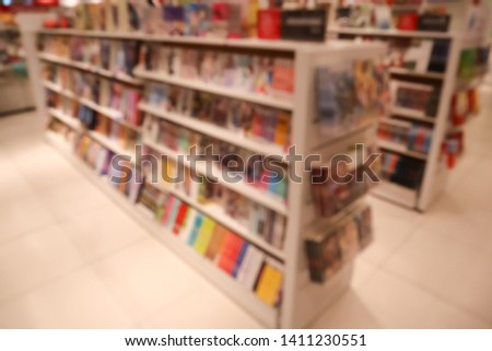 The defocus image of booksore. Blur abstract background of book and bookshelves. #1411230551