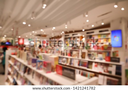 The defocus image of booksore. Blur abstract background of book and bookshelves. #1421241782