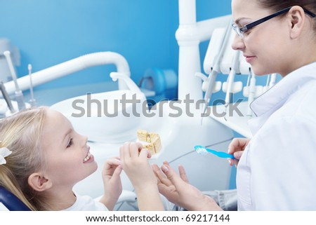The dentist and child in the dental office