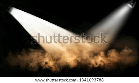 The design of the scene and the light shining on the stage with bright, brightly colored smoke.