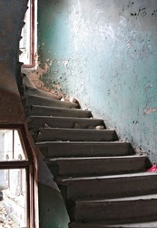 The destroyed spiral staircase of the old left house. Steps. Floors