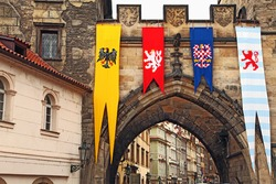 The detail of Old Town bridge tower with medieval flags, Prague