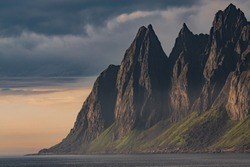 The Devils Jaw, or Tungeneset, is a spectacular range of jagged mountain peaks visible from the National Scenic Route on the Norwegian island of Senja.