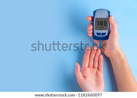 The diabetic measures the level of glucose in the blood. Diabetes concept. Copy space