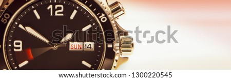 The dial of the wristwatch with a moving second hand symbolizing the run of time. A large plan.