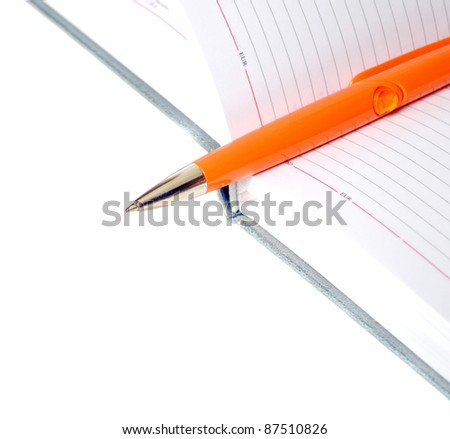 The diary and orange pen