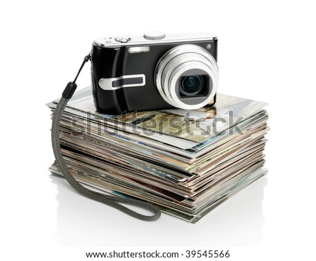 The digital camera and the heap of photos