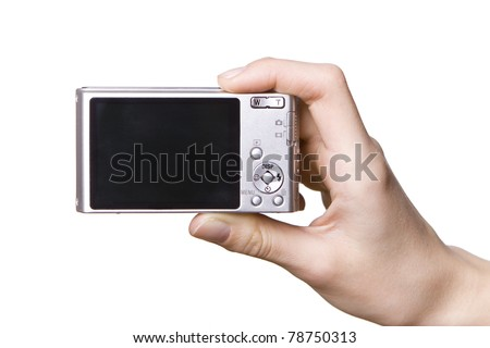 The digital camera in a hand, isolated on white