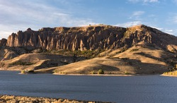 The Dillon Pinnacles rise above the Blue Mesa Reservoir in southwestern Colorado. Curecanti National Recreation Area has many recreation activities available for outdoor activities.