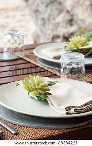 the dining table was decorated with the lotus flower for the romantic time