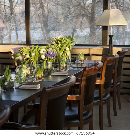 the dining table was decorated with the tulip  flower for the romantic time