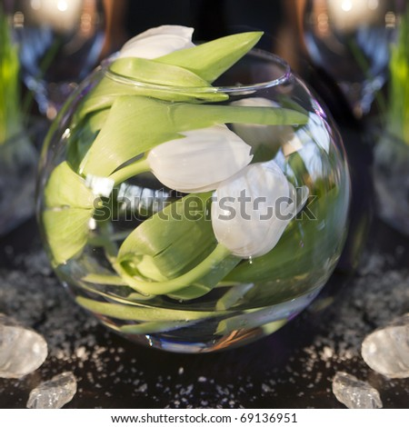 the dining table was decorated with the tulip  flower for the romantic time. Tulips  inside of vase