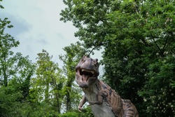 The dinosaur in the green forest