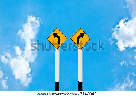 The Direction sign turn left and turn right isolated on sky background