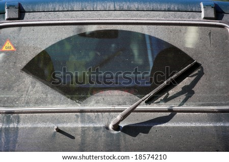 The dirty back window of an automobile