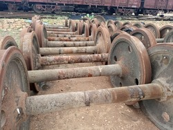 The discarded wheel assemblies of railway wagon at a junk yard