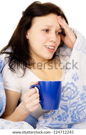 the diseased girl lying on the bed, and drink medicine isolated on white background