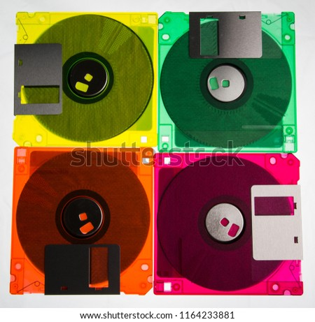 The diskettes 3/2 are a technology icons of de decade of 90s. Retro, vintage and colourful computer diskettes.