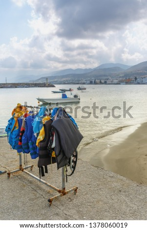 the diving suits hanging to dry on the embankment of the Greek city of Chersonissos #1378060019