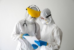 The doctor inquired about a communicable disease in the coronavirus vaccine covid-19.The doctor in the PPE protective suit asked the patient for personal information to test for covid-19  infection.