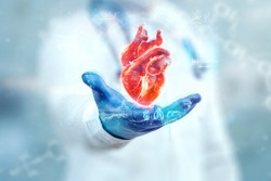 The doctor looks at the Heart hologram, checks the test result on the virtual interface, and analyzes the data. Heart disease, myocardial infarction, innovative technologies, medicine of the future