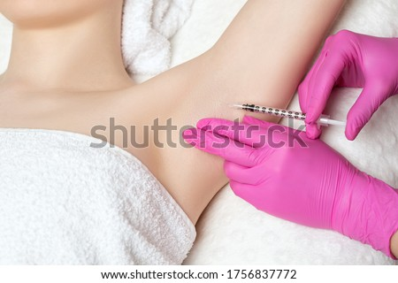The doctor makes injections of botulinum toxin in the underarm area against hyperhidrosis. Women's cosmetology concept. Photo stock ©
