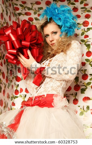 The doll in a gift box.