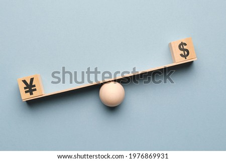 the dollar outweighs the yen on the scales Stock photo ©