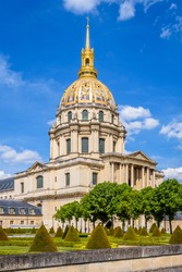 The Dome des Invalides in Paris, France, with its golden cupola, a former church which houses the tomb of Napoleon Bonaparte, and the southwest garden.