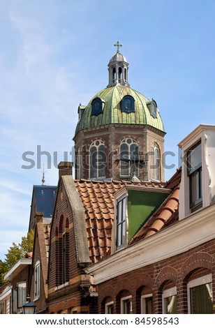 The dome of a monumental church in Hoorn, the Netherlands, viewed from a nice old residential street.