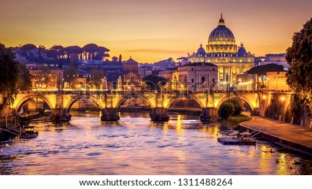The dome of Saint Peters Basilica and Vatican City at sunset. Sant'Angelo Bridge over the Tiber River. Rome, Italy #1311488264